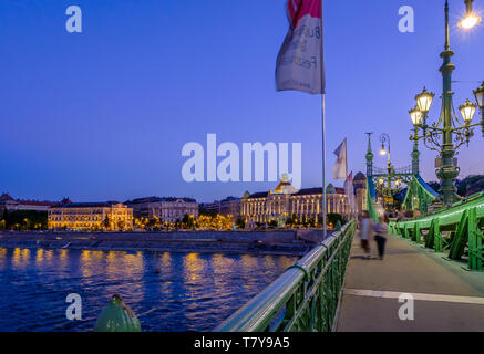 crossing Danube river on Liberty Bridge 'Szabadság hid' towards Buda and Gellért Hotel, at Hungarian capitol Budapest, night exposure - Stock Photo