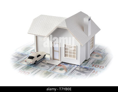 House miniature w/ car on U.S. dollar bills isolated in white background for real estate & construction concepts. House miniature made by contributor - Stock Photo