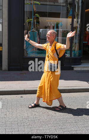 Antwerp, Belgium  - July 14, 2018: Indian monk In the great city of Antwerp during an indian parade - Stock Photo