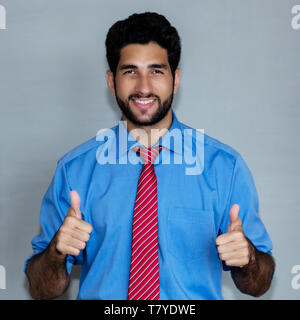 Portrait of successful latin american hipster businessman on grey background - Stock Photo