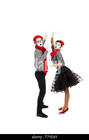 mimes in striped shirts. Male and female mimes dancing isolated on white background - Stock Photo