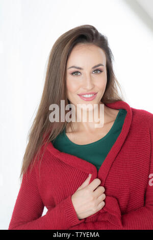 Portrait of young woman waring sweater - Stock Photo
