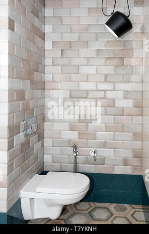 White toilet bowl with bidet shower in the bathroom - Stock Photo