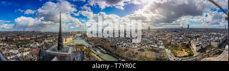 Aerial ultra wide Panorama cityscape of Paris. Skyline and famous landmarks central downtown buildings in the French capital. - Stock Photo