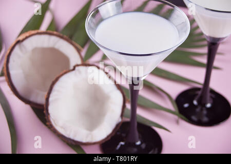 Pina Colada tropical cocktail with palm leaf and coconut on the background - Stock Photo