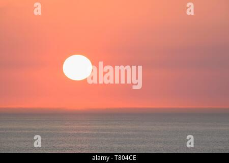 Sunset over calm sea, Wangerooge, East Frisian Islands, North Sea, Lower Saxony, Germany - Stock Photo