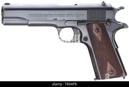A Colt mod. 1911, cal..45 ACP, no. C112263. Bright bore. Manufactured in 1919. On left side of slide two-line corporate name and patent data, on the right 'COLT Automatic Calibre .45', on frame marked 'Government Model'. Complete, original blue-black Colt-blue, few weak wear marks on grip. Flawless walnut grip panels. Correct magazine hardened in upper third. Rare collectors' item without any different stamps in original and almost mint condition. Erwerbsscheinpflichtig. historic, historical, civil handgun, civil handguns, handheld, gun, guns, fi, Additional-Rights-Clearance-Info-Not-Available - Stock Photo