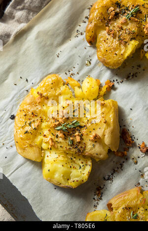 Homemade Smashed Potatoes with Garlic Salt and Thyme - Stock Photo