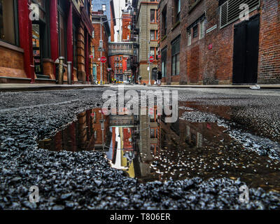 NEW YORK, NY - APRIL 30, 2019:  Staple Street Skybridge between Jay and Harrison Street with reflection in water after rain. - Stock Photo
