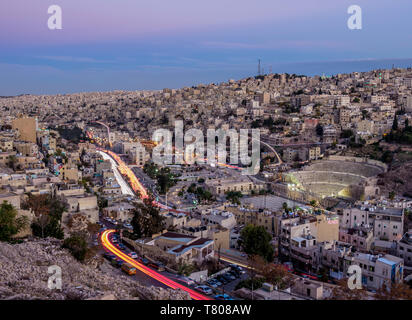 Cityscape seen from Citadel Hill at dusk, Amman, Amman Governorate, Jordan, Middle East - Stock Photo