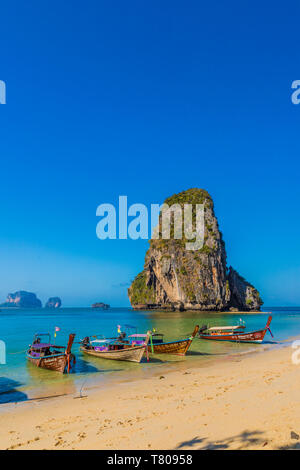 Long tail boats on Phra Nang Cave Beach on Railay in Ao Nang, Krabi Province, Thailand, Southeast Asia, Asia - Stock Photo