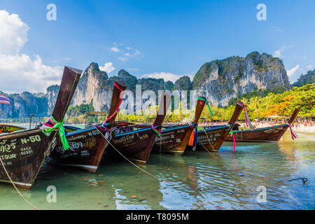 Long tail boats and karst scenery on Railay beach in Railay, Ao Nang, Krabi Province, Thailand, Southeast Asia, Asia - Stock Photo