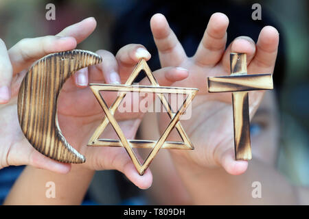 Christianity, Islam, Judaism, the three monotheistic religions with symbols of Jewish Star, Muslim Crescent and Christian Cross, Vietnam - Stock Photo