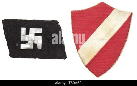 A right collar patch for enlisted men/NCOs of the 15th Waffen Grenadier Division of the SS (Latvian no. 1). Local issue of black woollen material with hand-sawn metal appliqué in the shape of a swastika. Moth traces, reverse glue residue. Included is the corresponding sleeve shield of local production in the state colours of red with diagonal white stripes. historic, historical, 20th century, 1930s, 1940s, secret service, security service, secret services, security services, police, armed service, armed services, NS, National Socialism, Nazism, Third Reich, German Reich, Ge, Editorial-Use-Only - Stock Photo