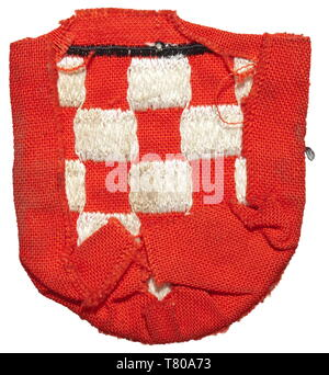 A sleeve shield for Croatian volunteers in the 13th Waffen Mountain Division of the SS 'Handschar' (Croatian no. 1) or the 23rd Waffen Mountain Division of the SS 'Kama' (Estonian no. 2). Machine-embroidered issue in red cotton cloth. historic, historical, 20th century, 1930s, 1940s, secret service, security service, secret services, security services, police, armed service, armed services, NS, National Socialism, Nazism, Third Reich, German Reich, Germany, utensil, piece of equipment, utensils, object, objects, stills, clipping, clippings, cut out, cut-out, cut-outs, fasci, Editorial-Use-Only - Stock Photo