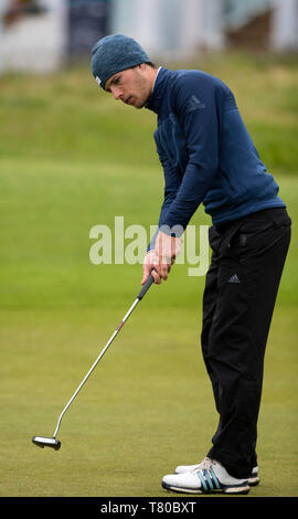 Hillside Golf Club, Southport, UK. 9th May, 2019. Betfred British Masters, hosted by Tommy Fleetwood, first round ; Matthew Jordan (ENG), leading the tournament at nine under par, follows his birdie putt on the 18th green Credit: Action Plus Sports/Alamy Live News - Stock Photo