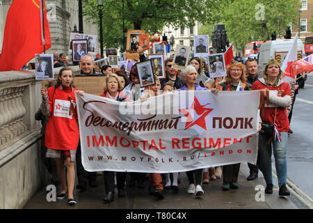 London, UK. 09th May, 2019. LONDON, UNITED KINGDOM - MAY 9, 2019: People carry portraits of their relatives who fought in WWII as they take part in the Immortal Regiment march marking the 74th anniversary of the Victory over Nazi Germany in World War II. Igor Brovarnik/TASS Credit: ITAR-TASS News Agency/Alamy Live News - Stock Photo