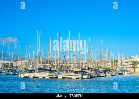 Yachts and motor boat in luxury marina at sunset. Portugal - Stock Photo