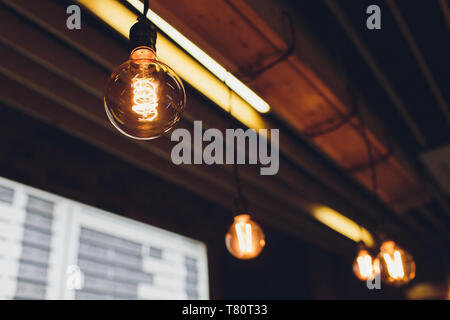 Retro light bulbs hanging in department store, with decorate interior luxury, fixtures combine beautiful modernity Designer, lamps on the ceiling, bea - Stock Photo