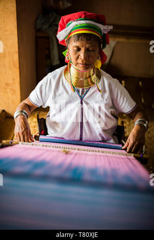 Long necked woman from Padaung tribe weaving at Inle Lake, Shan State, Myanmar (Burma), Asia - Stock Photo