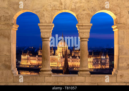 The Hungarian Parliament at night, viewed from the columns of the Fisherman's Bastion, UNESCO World Heritage Site, Budapest, Hungary, Europe - Stock Photo