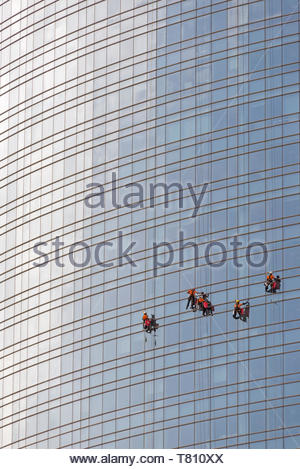 Window cleaners at work, Unicredit Tower façade, Milan, Italy - Stock Photo