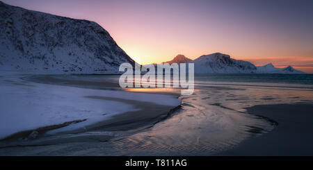 Snow covered Haukland Beach at sunset, Lofoten, Nordland, Norway, Europe - Stock Photo