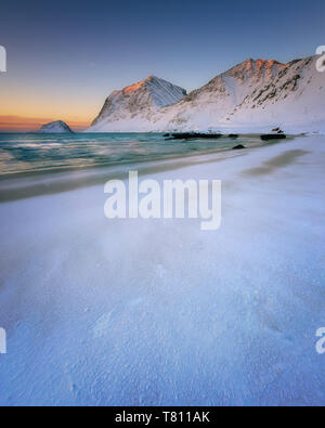 Snow covered Haukland Beach at sunset, Lofoten Islands, Nordland, Norway, Europe - Stock Photo