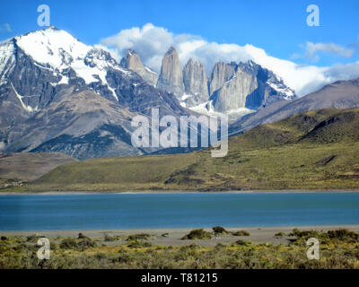 Torres del Paine National Park, picturesque landscape over Pehoe lake towards majestic snow covered mountain peaks taken from the trek, Patagonia, Chi - Stock Photo
