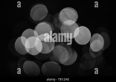 Bright and festive atmosphere of coming holiday. Christmas decorations concept. Defocused light of colorful garland. Abstract colorful bokeh background. Festive backdrop with colorful lights. - Stock Photo