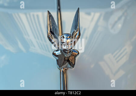 Dnipro, Ukraine - September 29, 2018: Decoration in the form of a flying lady on hood ornament of an old car made of chromed metal - Stock Photo
