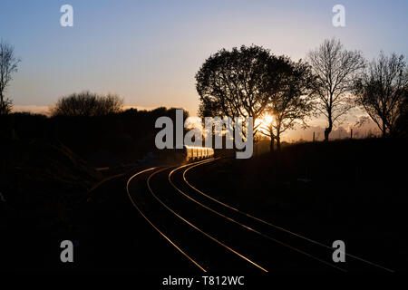 2 First Great Western railway Hitachi Intercity Express trains  ( IEP ) head into the sunset at Crofton, Wiltshire - Stock Photo