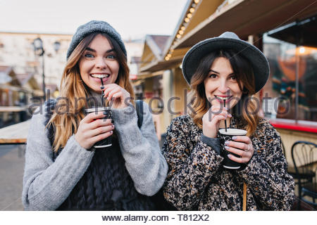 Selfie portrait of joyful fashionable girls having fun on sunny street in city. Stylish look, having fun, travelling with friends, smiling, expressing true positive emotions - Stock Photo