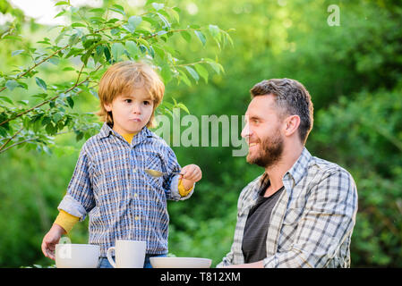 Happy family together. childhood happiness. Food habits. happy fathers day. Little boy with dad. Preparation of food. healthy food and dieting. son and father eating milk porridge. Summer taste. - Stock Photo