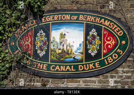 Colourful plaque on stone bridge over Grand Union Canal Berkhamsted Hertfordshire England - Stock Photo