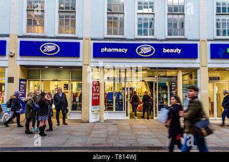 People walking past the front of Boots pharmacy or chemist in Oxford, UK. December 2018. - Stock Photo