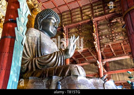 Great bronze Buddha statue in Todaiji Temple, Nara Prefecture, Japan - Stock Photo
