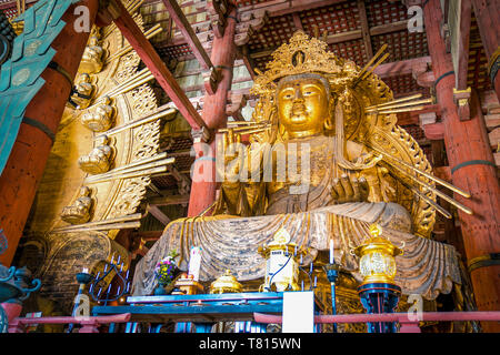 Gold Giant Guan Yin Statue in Todaiji temple, Nara Prefecture, Japan - Stock Photo