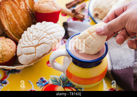 Concha and chocolate, mexican sweet bread and atole beverage in mexico breakfast - Stock Photo