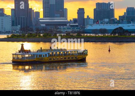 Bey Trekker tourist boat sailing in Tokyo Bay at sunset - Stock Photo