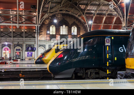 London Paddington station, the yellow Network Rail HST new measurement train and Great western Hitachi  Intercity Express trains - Stock Photo