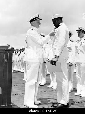 WWII, Admiral Nimitz Awards the Navy Cross to Dorie Miller, 1942 - Stock Photo