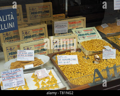 View of Tortellini and other pasta on display in a shop window in Bologna Italy - Stock Photo
