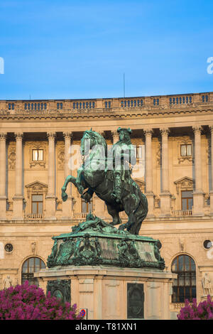 Vienna city, view of the statue of Prince Eugene of Savoy against the backdrop of the Neue Burg building in the Hofburg Palace complex, Austria. - Stock Photo