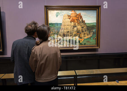 Kunsthistorisches Museum Vienna, rear view of a young couple looking at The Tower Of Babel by Bruegel inside the Kunsthistorisches Museum, Austria. - Stock Photo