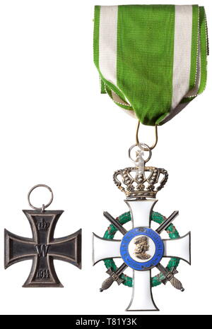 A Commander's Cross to the Order of Albert with Swords bestowed in 1915 to Prussian Oberst (Colonel) Wilhelm Rotte, staff officer of the engineer and pioneer corps of fortress Posen and later general of pioneers. The Cross of the Order in gilt silver issue ('S' in lower cross arm) of the Scharffenberg firm in Dresden with corresponding designation in the lateral cross arms. On an especially long, original neck ribbon. Numerous small defects in the blue enamel of the medallion, otherwise very beautiful. Included is the general's Iron Cross 2nd Cla, Additional-Rights-Clearance-Info-Not-Available - Stock Photo