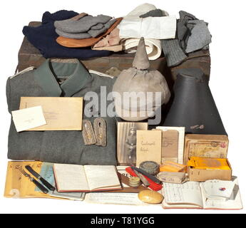 The large estate of uniforms and documents from the possessions of Reserve Lieutenant Rudolf Abel from Stade. A Prussian field tunic M 1915 for an infantry lieutenant, made of field-grey cloth, dark green collar, covered button flap, sewn-on shoulder boards, and green lining. The tunic in perfect, unissued condition. A spiked helmet M 1915 for infantry officers, from circa 1918. Th 20th century, Additional-Rights-Clearance-Info-Not-Available - Stock Photo