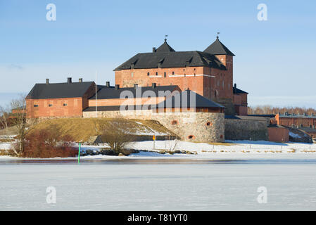 The old fortress-prison on the shore of Vanajavesi lake on a sunny March day. Hameenlinna, Finland - Stock Photo
