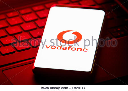 File photo dated 07/12/18 of the logo of mobile phone network Vodafone displayed on the screen of a smartphone. Telecoms giants have been urged to scrap charges for calling the 101 police non-emergency number as the Home Office promised a review of the 15p cost. - Stock Photo