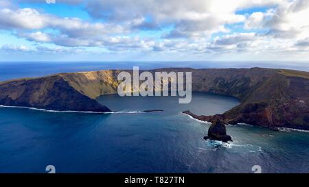 France, Indian Ocean, French Southern and Antarctic Lands, Saint-Paul island, the cliff with Quille Rock in the foreground (aerial view) - Stock Photo